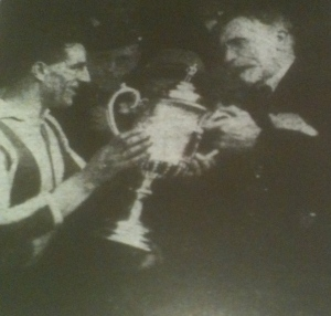 Captain Tommy Jennings collects the Cheshire Senior Cup from Edward Case, President of the Cheshire FA- Cheshire Observer