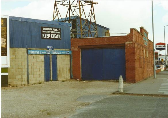 The Sealand Road End in 1990 showing the brickwork that was added in 1935. The plaque is just visible by the lamppost. Copyright © http://www.chesterfootballhistory.com